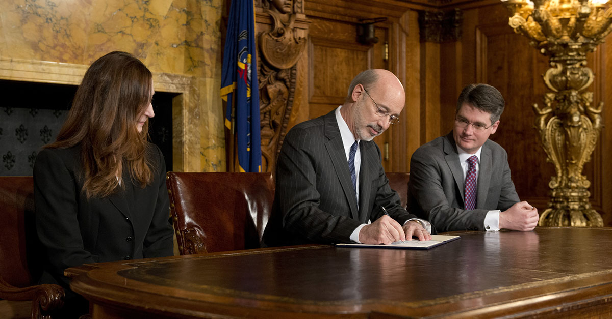 Governor Wolf, Secretary Minnich, and Secretary Topper at executive order signing