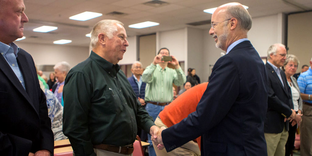 Image of Governor Wolf shaking hands