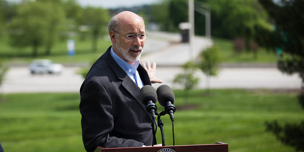 image of governor wolf speaking in front of road