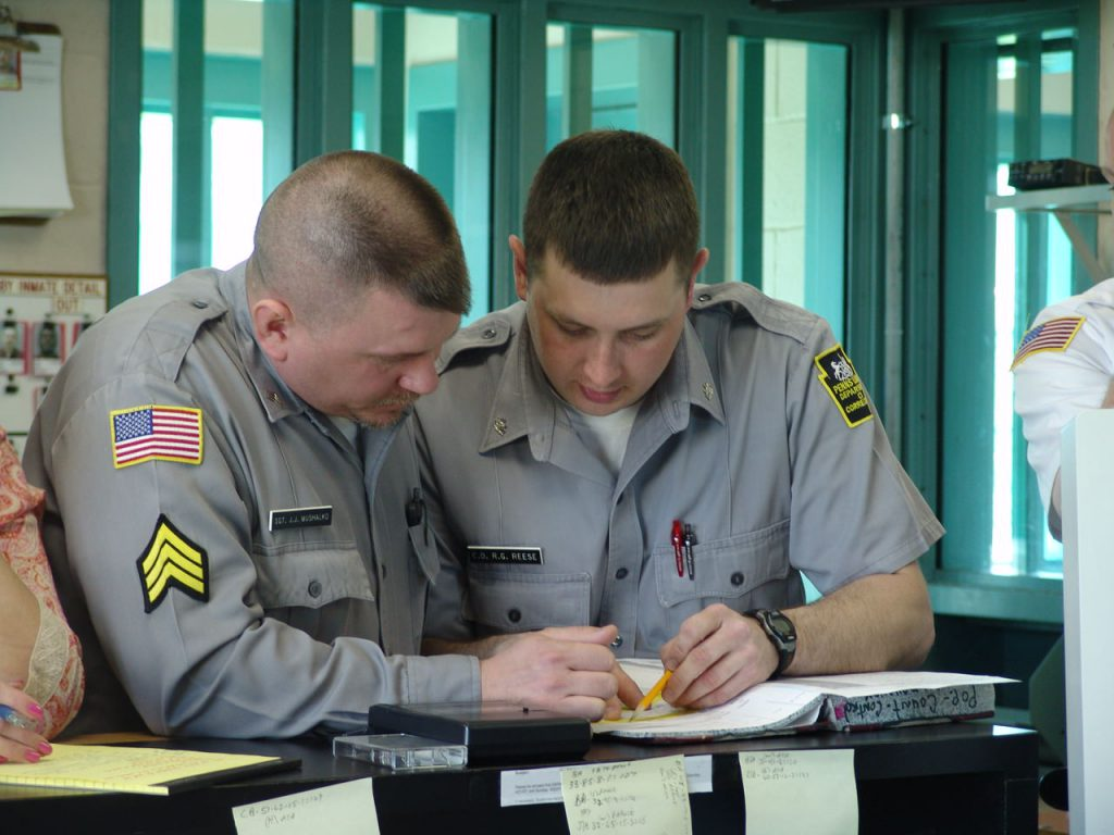 Image of officers writing on a document