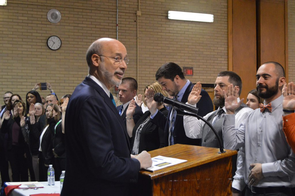 Image of people taking an oath with Governor Tom Wolf
