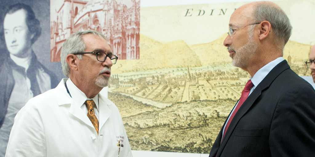 Image of Governor Wolf speaking to a doctor