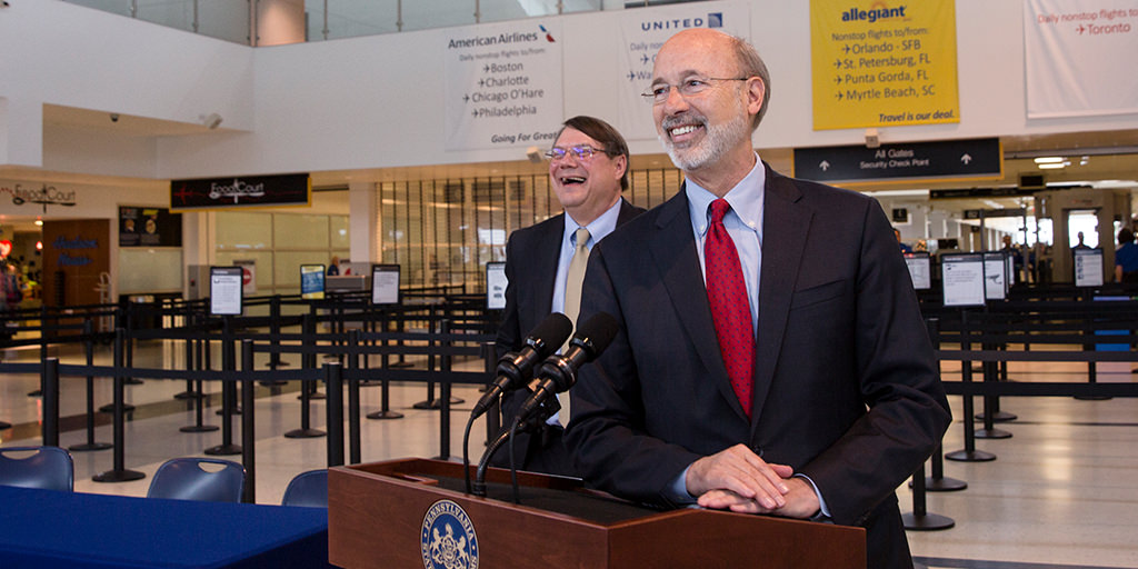 Image of Governor Wolf speaking at an airport