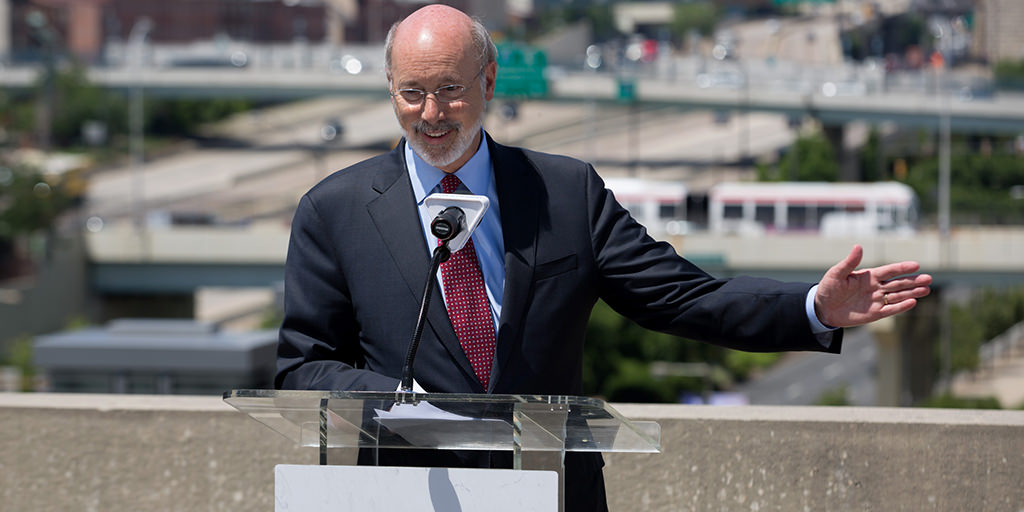 Image of Governor Wolf speaking in front of I-95
