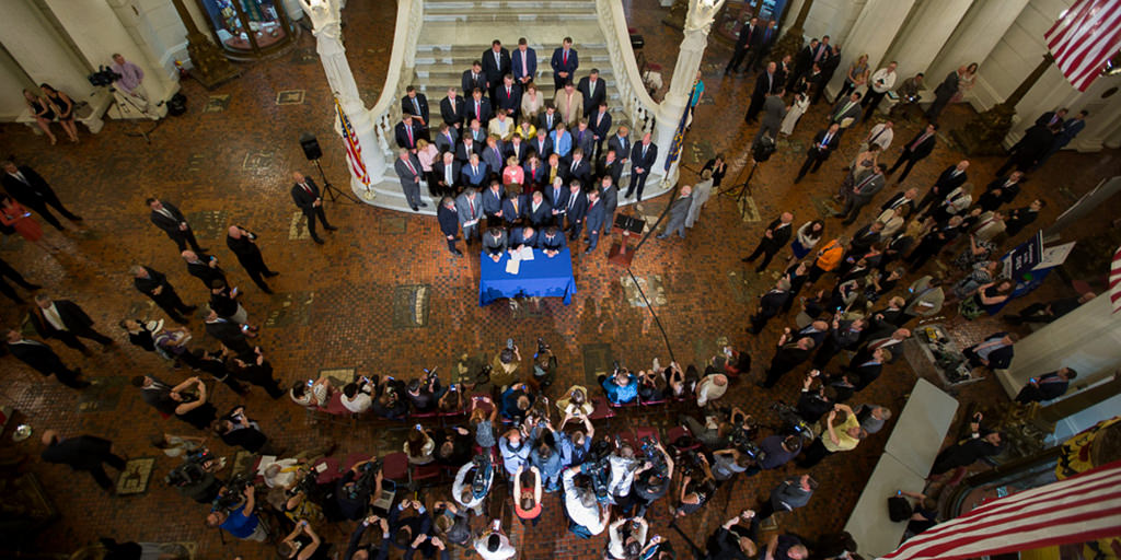 Image of Governor Wolf signing pension reform bill