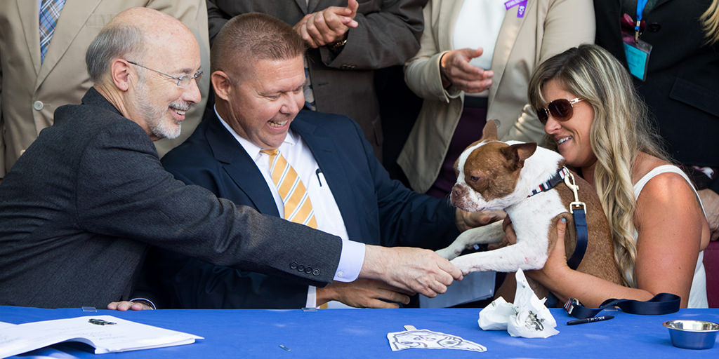 Image of Governor Wolf with dog