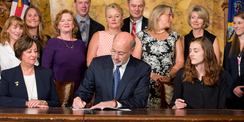 Image of Governor Wolf signing a bill