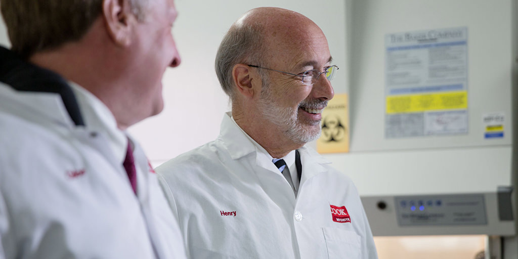 Image of Governor Wolf wearing a borrowed lab coat