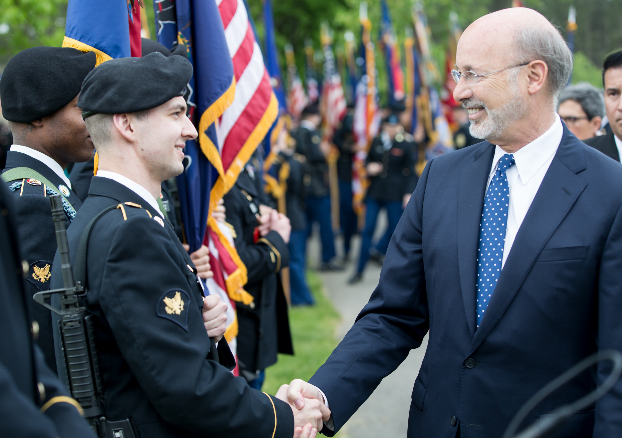 Governor Tom Wolf shaking hands with service member
