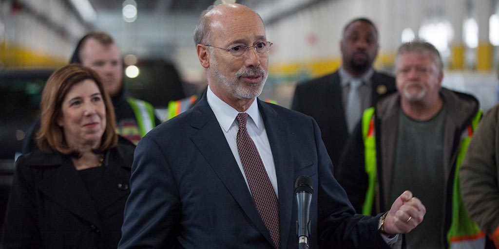 Image of Governor Wolf at a port in Philadelphia