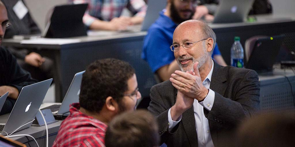 Image of Governor Wolf applauding students