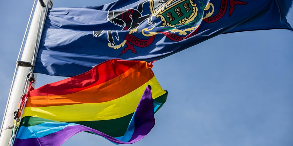 Image of LGBT flag and Pennsylvania flag