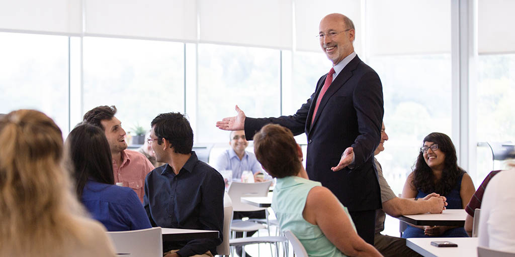 Image of Governor Wolf speaking to seated people