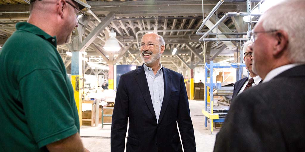 Image of Governor Wolf in a manufacturing warehouse