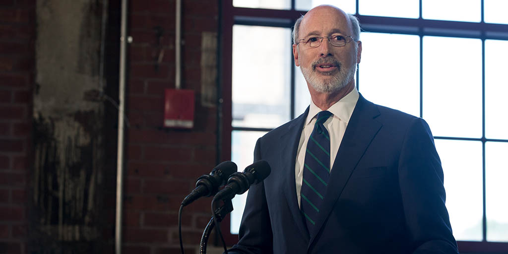 Image of Governor Wolf in a warehoues