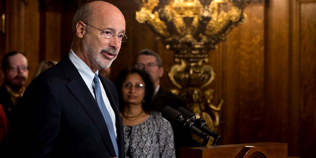 Image of Governor Wolf speaking behind a podium