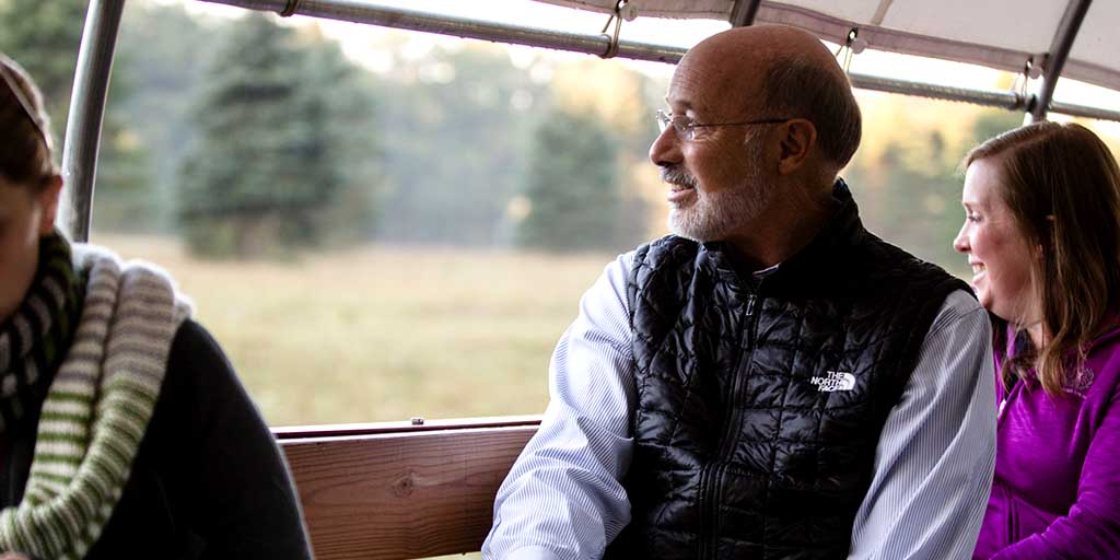 Image of Governor Wolf riding a vehicle