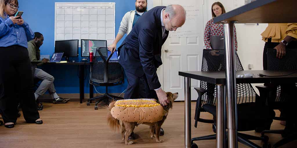 Image of Governor Wolf petting a dog