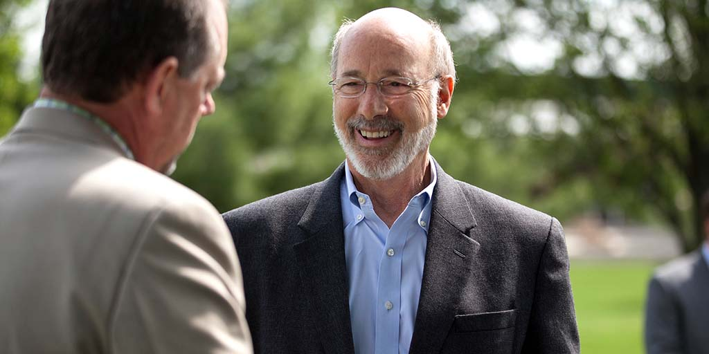 Image of Governor Wolf speaking to someone