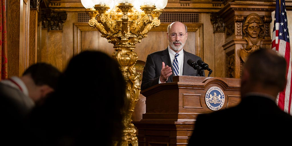 Image of Governor Tom Wolf speaking behind a podium.