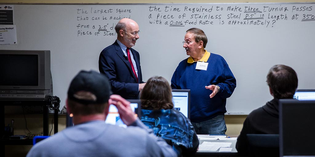 Image of Governor Wolf speaking to an instructor.