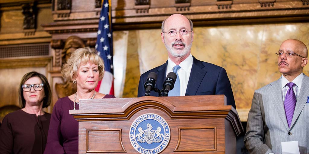 Image of Governor Tom Wolf speaking from behind a podium.