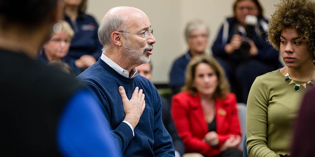 Image of Governor Tom Wolf holding his hand to his chest and speaking to a group of people.