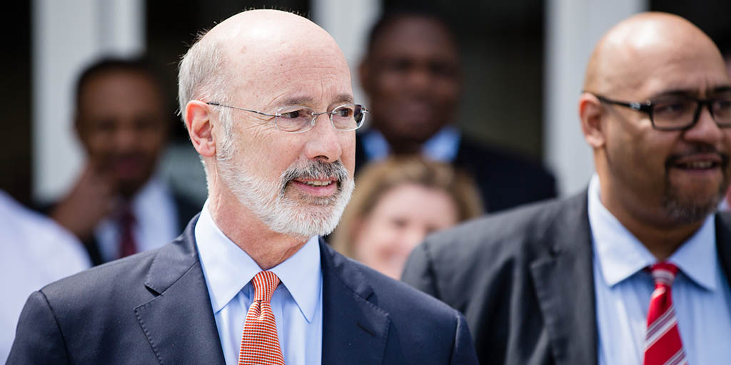 Image of Governor Tom Wolf speaking with Secretary of the Department of Corrections.