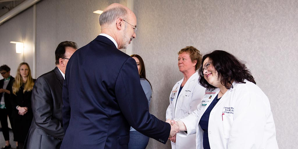 Image of Governor Tom Wolf shaking hands with a doctor.