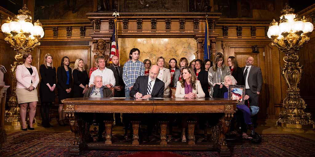 Image of Governor Tom Wolf signing a bill into law.