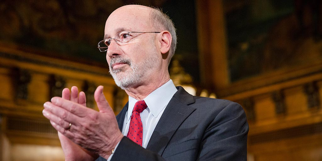 Close up image of Governor Tom Wolf applauding.