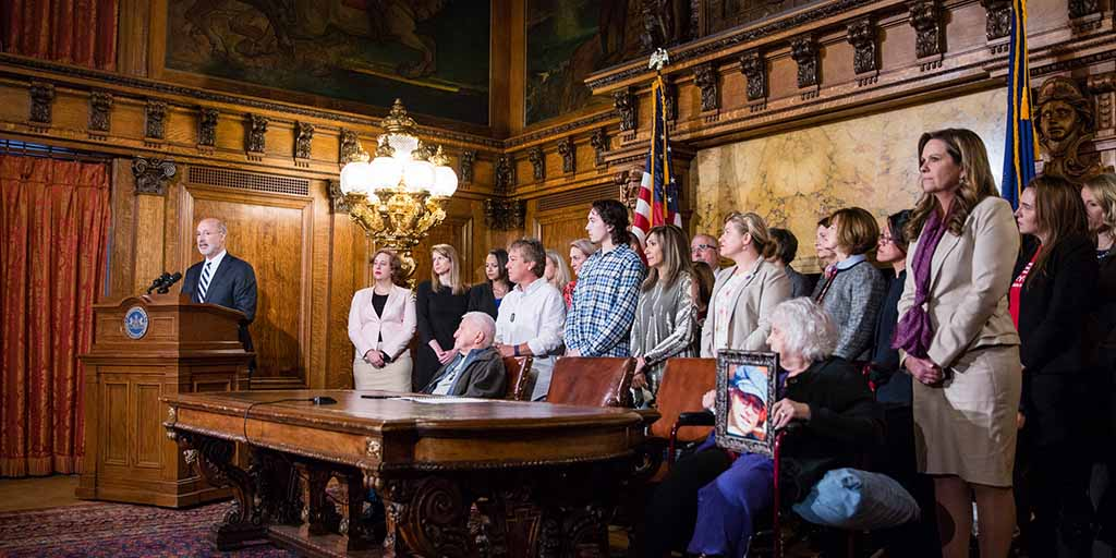 Image of Governor Tom Wolf speaking behind a podium at the governor's reception room.