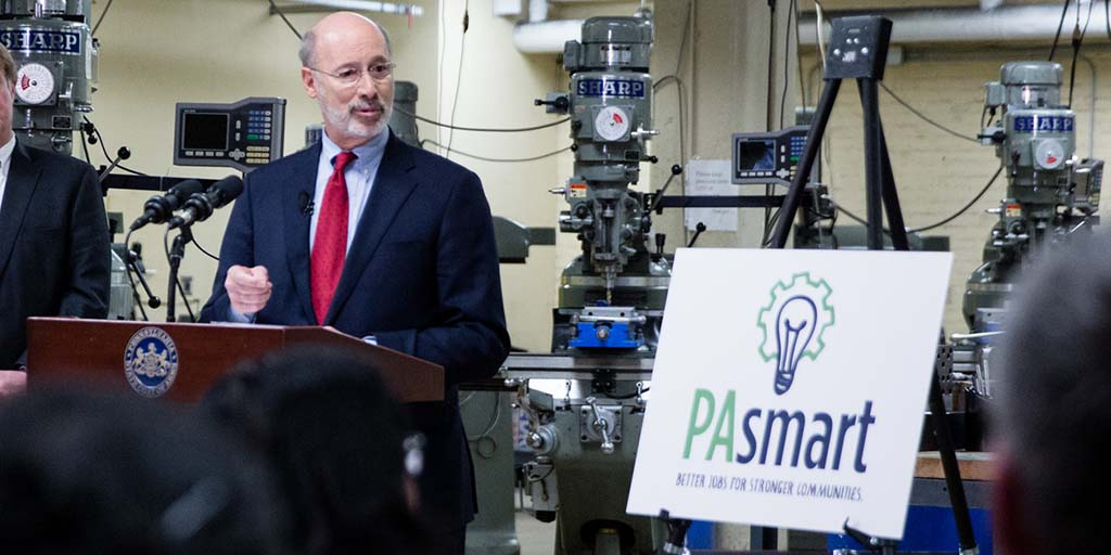 Image of Governor Tom Wolf speaking next to a PAsmart sign