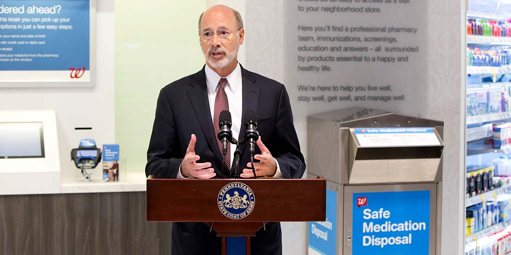 Image of Governor Tom Wolf speaking next to a Drug Take-Back box.