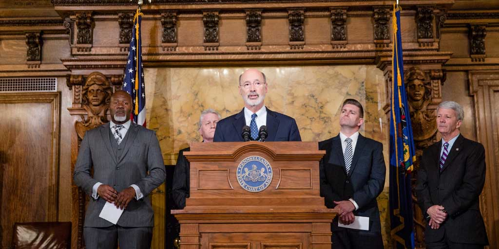 Image of Governor Tom Wolf speaking behind the podium in the governor's reception room.