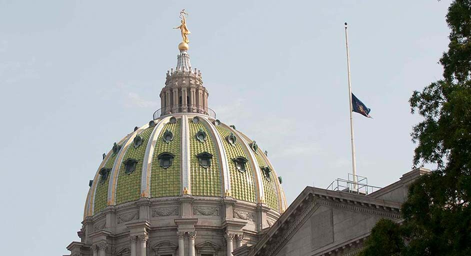 Image of the Commonwealth flag at half-staff