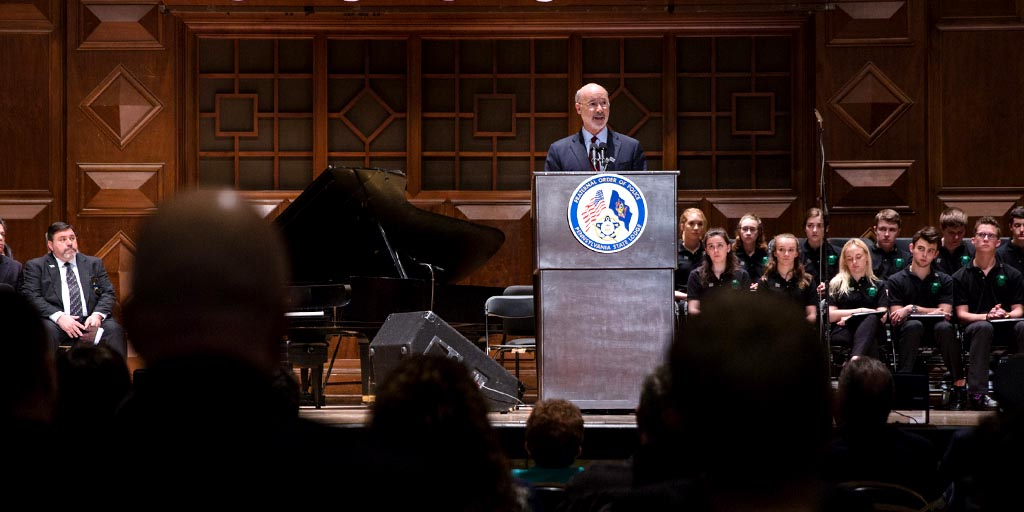 Image of Governor Tom Wolf speaking at a memorial service.