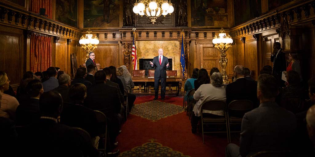 Image of Governor Tom Wolf speaking to state employees in the governor's reception room.