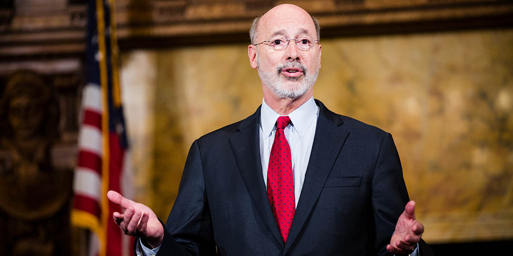 Image of Governor Tom Wolf with his hands out in front of him.