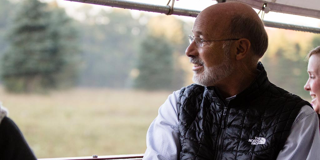 Image of Governor Tom Wolf looking out into the forest.