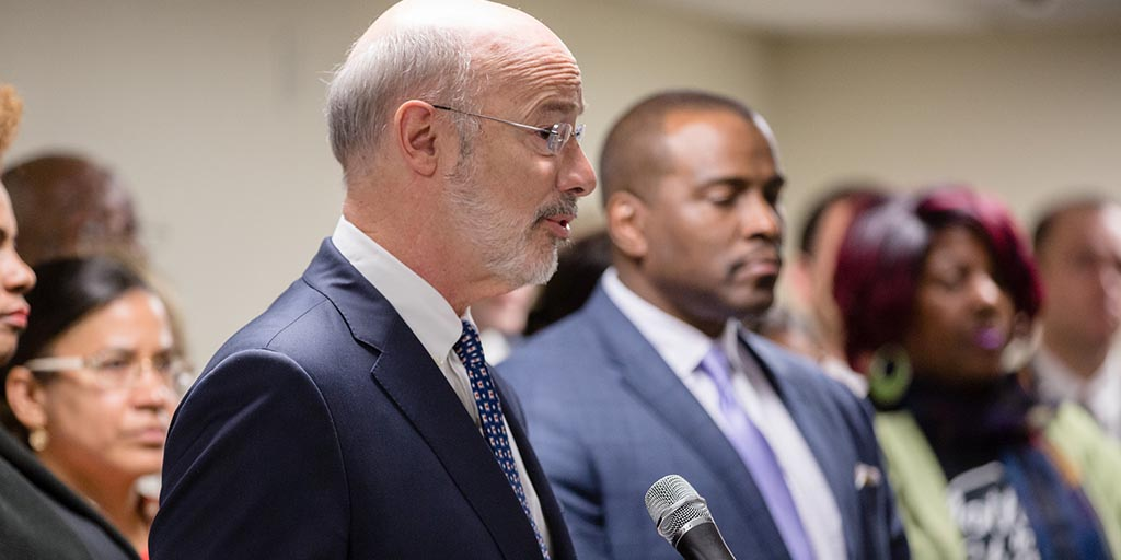 Image of Governor Tom Wolf speaking along side officials and community leaders.