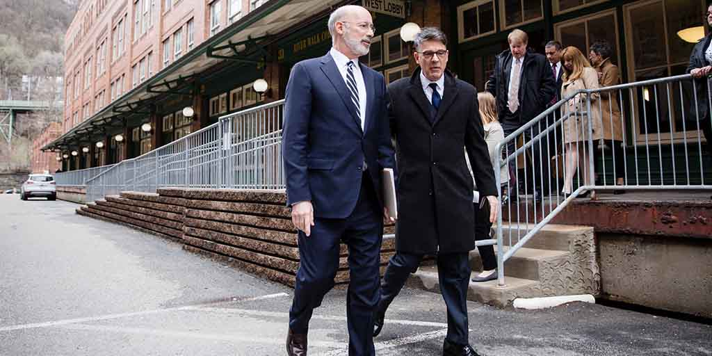 Image of Governor Tom Wolf walking down an alleyway.
