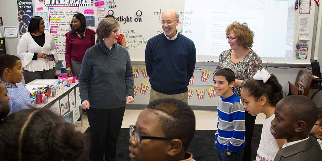 Image of Governor Tom Wolf and First Lady Frances Wolf speaking to a class of students.