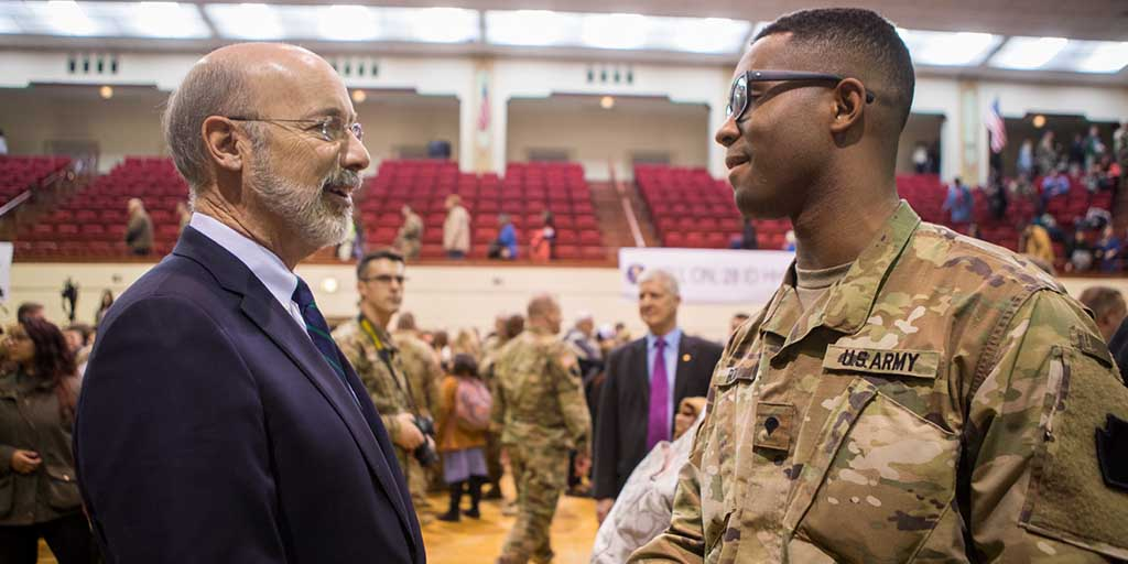 Image of Governor Tom Wolf shaking hands with a member of the armed forces.