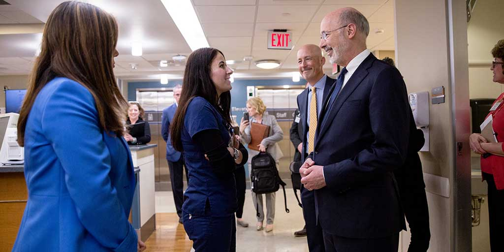 Image of Governor Tom Wolf greeting medical staff at a hospital.