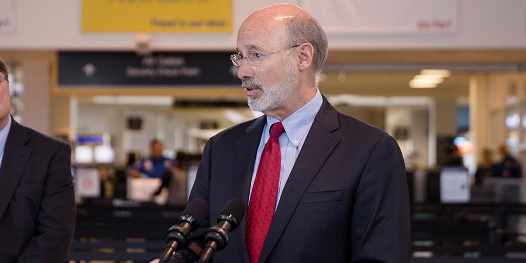 Image of Governor Tom Wolf at an airport terminal.