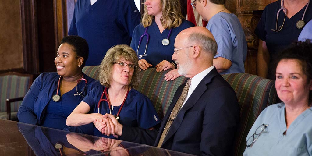 Image of Governor Tom Wolf shaking hands with a nurse.
