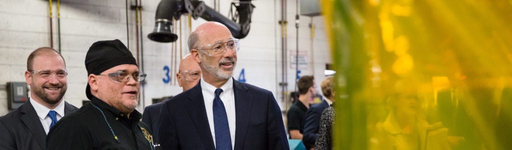 Image of Governor Tom Wolf speaking to employees in welding facility.