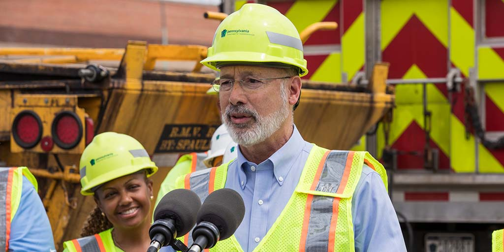 Image of Governor Tom Wolf wearing PennDOT gear while providing remarks.