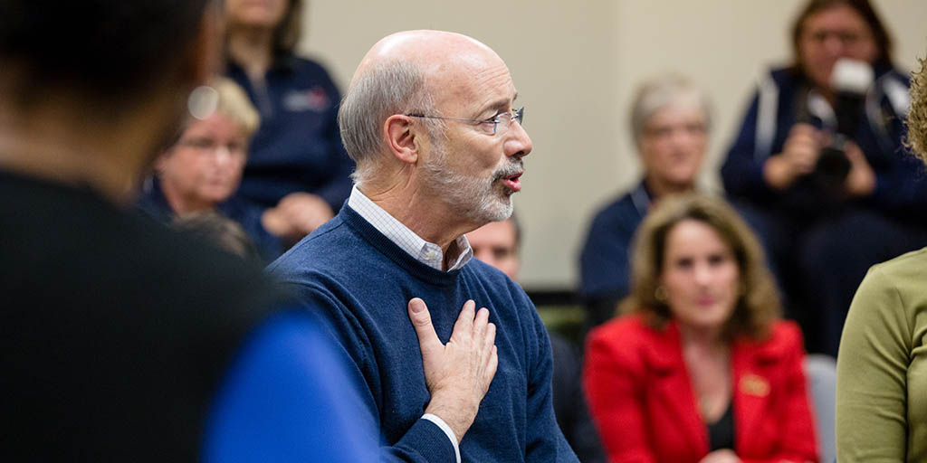 Image of Governor Tom Wolf with his hand on his chest.